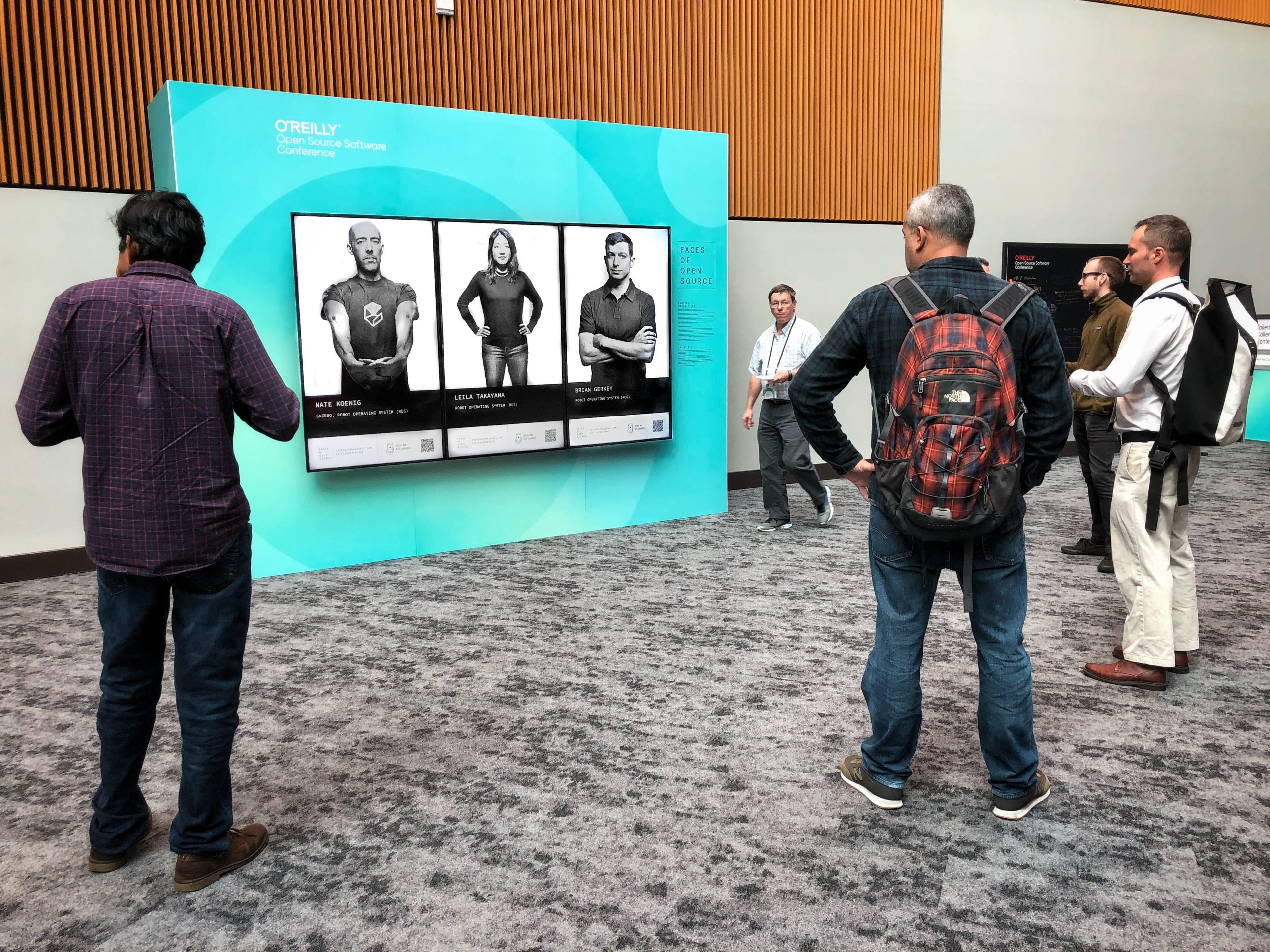 OSCON attendees stop to view a contributors from the Robot Operating System (ROS) project.